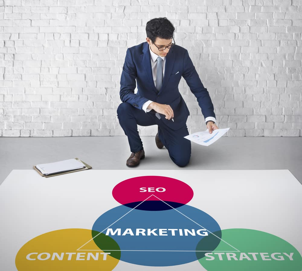 business man considering the link between SEO, content, marketing and strategy